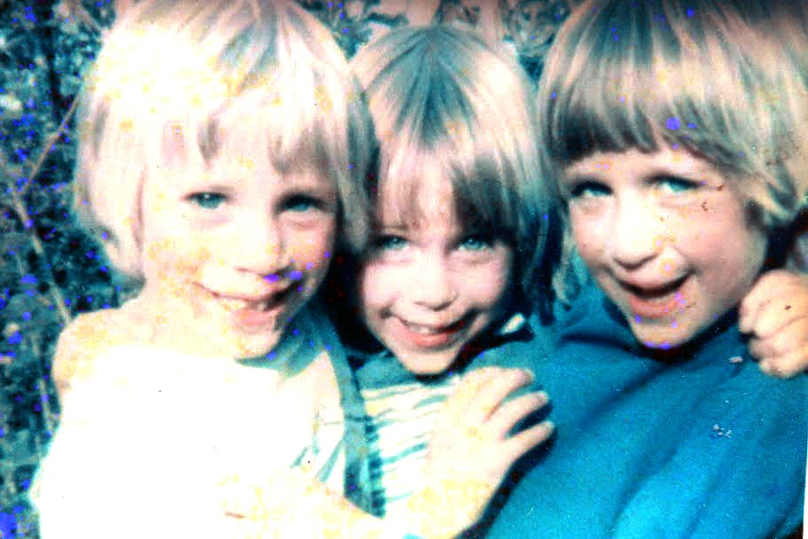 Three triplet kids in a photo taken a long time ago.