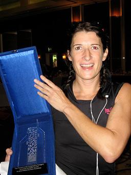 Jo holding an award.