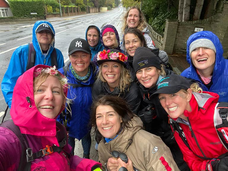Jo and female friends gather in the wet weather.