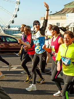 Jo waves to the crowd whilst running on Madeira Drive.