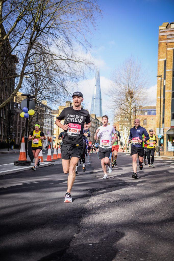 Rich Williamson running in a marathon alongside other runners.