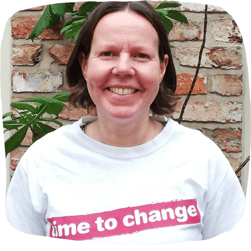 """Emma wears a """"time to change"""" T-shirt."""